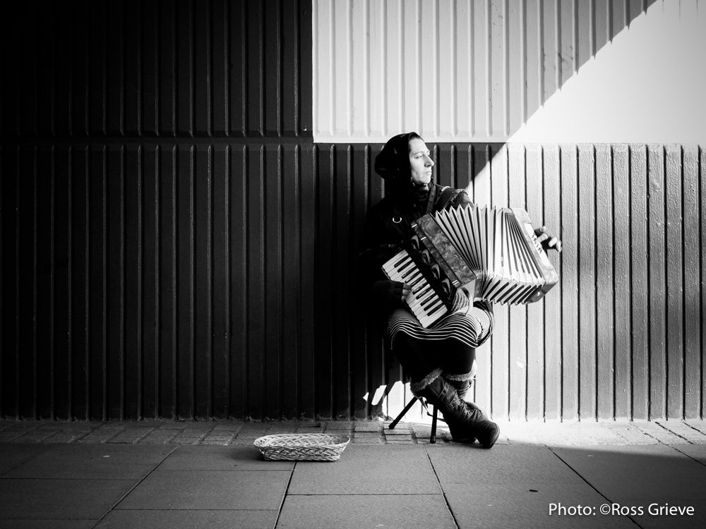 Busker in Cardiff. Silent Street Photography